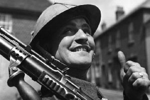 6th June 1944:  A British soldier, encamped in a small English village, gives the thumbs-up as he awaits his orders for D-Day.  (Photo by Fox Photos/Getty Images) PPP-190506-103143003