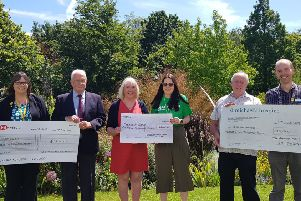 Representatives from  Marie Curie, Macmillan Cancer Support and St Michael's Hospice, each reeive a cheque for �25,000 from members of  The Brewery Yard Club, Rye. SUS-190625-155029001