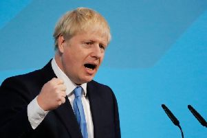 Prime minister Boris Johnson gives a speech at an event to announce the winner of the Conservative Party leadership contest in central London on July 23, 2019. (Photo by Tolga AKMEN / AFP)