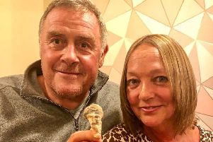 Debra Oliver and her husband Martin holding their surprising shell. Picture: SWNS