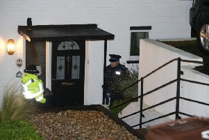 Police in Brighton last night. A man and woman were arrested on suspicion of murder