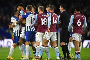 Players from both teams pile in as tempers boiled over after the final whistle at the Amex Stadium