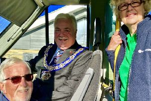 Stephanie Kirby and Clive Lester (left), on behalf of Whitbread Wanderbus Ltd, with Tony Henderson, leader of Bedfordshire Freemasons.