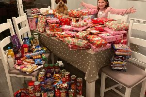 Millie with the presents and food hampers she donated