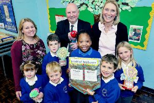 L to R: Jo Dormer (Deputy Headteacher), CALA Homes' Patrick Danagher and Elizabeth Fordham (Mind Map Charity) with Daisy (5), Euan (8), James (4), Maya (9), Niko (7) and Imogen (8). Photo by Tim George