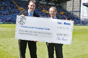 Neil Allen hands over a cheque to former Pompey director Mick Williams for monies raised through the sales of Sports Mails