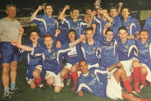 The Portsmouth Schools team celebrate winning the English Schools' Football Association's Under-15 Inter Association Trophy in 2004 with team manager Graham Bryant, far left