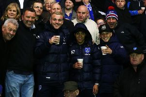 Kyle Bennett, with hood up, alongside Pompey team-mates Jack Whatmough and Conor Chaplin and Blues supporters on the trip to AFC Wimbledon's Kingsmeadow on Tuesday night