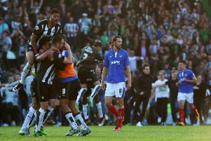 Christian Burgess trudges off the Home Park pitch as Plymouth celebrate their League Two play-off semi-final victory last season. Picture: Joe Pepler