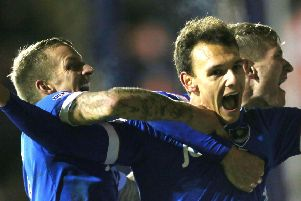 Kal Naismith is mobbed after scoring Pompey's third goal against Luton. Picture: Joe Pepler