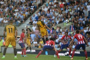 Steve Sidwell heads home Albion's second goal against Atletico Madrid. Picture by PW Sporting Pics