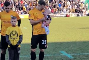 Mickey Demetriou with his son, Theo, on the pitch before Newport's FA Cup third round tie with Leeds