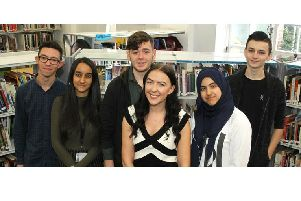 Hove Park School former student Kelly Romero (fourth from left) with sixth formers.