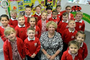 Headteacher Jacqueline Cobb and some of the children from Nyewood Infants School