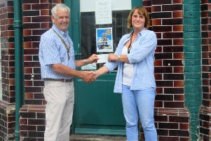Bognor Hotham Rotary president Terry Farndell, presenting the first �100 cheque to Mandy who helps to manage the food bank store in Bognor Regis