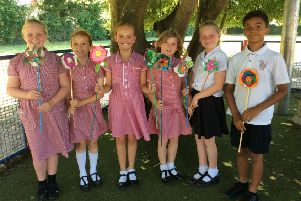 Georgian Gardens Community Primary School pupils with the flowers they made for the summer display