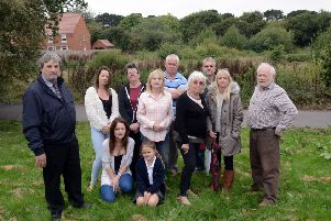 Councillor English, left, with residents concerned about the development proposed for the land behind them. Photograph: Kate Shemilt/ ks180449-1