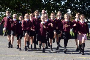 Headteacher of Nyewood C of E Junior School Mr Jon Williams and pupils delighted with the Ofsted report. Photograph: Kate Shemilt/ ks180470-1