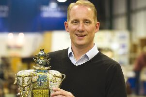 Toovey's Asian art specialist, Tom Rowsell, with one of a pair of rare Chinese Qianlong period cloisonne enamel elephants from an important London single owner collection of Asian art.