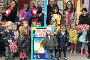Staff and children at the nursery