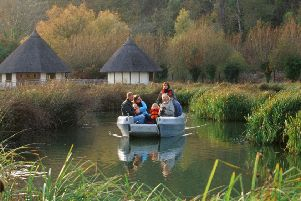 Family on a boat at Arundel Wetland Centre
