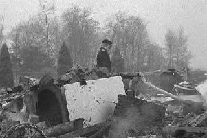 Aftermath of the crash in which a plane demolished a house near Gatwick Airport. Photo: Surrey Police