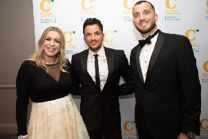 Peter Andre with Lorna (parent speaker) and Steve Cobbett at Chestnut Tree House fundraising ball SUS-190122-174011001