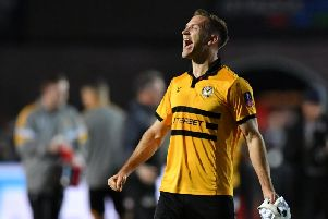 Mickey Demetriou celebrates Newport's win over Leicester - now he has a replay at home to Middlesbrough to look forward to / Picture by Getty Images