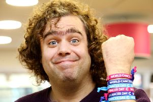Daniel Wakeford wearing World Cancer Day unity bands