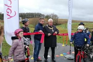 Councillor Burgess cut the ribbon