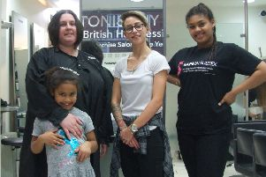 Rachel with her daughters Aiesha, 15, and Tamina-Grace, seven, and hairdresser Lauren