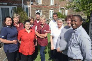 ks190238-1 Cherington House phot kate'Managers Lorraine Davis and Abel Mberi, right, and staff at Cherington House nursing home delighted with their CQC rating.ks190238-1 SUS-190430-191119008