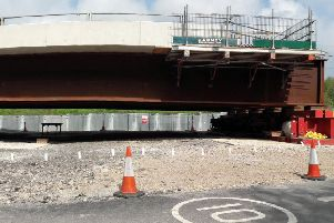 A huge new motorway bridge will be lifted in to place over the M27