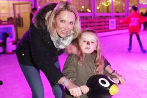 DM18113223a.jpg. Opening of Chichester Ice Rink in Priory Park. Stacey Love and daughter Florence aged 3. Photo by Derek Martin Photography. SUS-181130-185527008