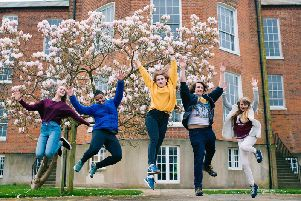 Students jumping outside the university