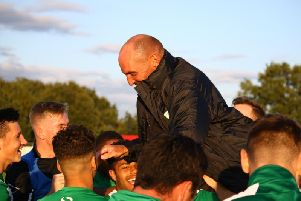 Boss Miles Rutherford gets a lift from his Chichester players after the win over Bowers and Pitsea / Picture: Jordan Colborne