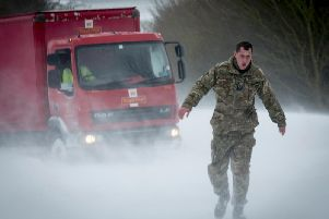 RAF Wittering personnel helping out motorists in the snow in Lincolnshire last week