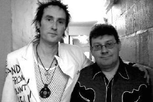 Pictured left is Jock Mclelland from the Band From County Hell with Jake Burns of Stiff Little Fingers backstage when they supported them at Rock City, Nottingham. EMN-180626-144829001