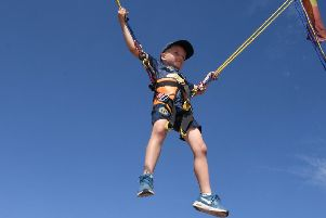 Up, up and away... Noah Williams (7) on the bungee trampoline. EMN-180608-091615001