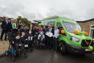 On behalf of Lord's Taverners Rory Underwood presents Boston's John Fielding Special School with a new bus. Rory, right, with headteacher Richard Gammon, representatives from Lord's Taverners and pupils from the school''Picture: Sarah Washbourn /www.yellowbellyphotos.com
