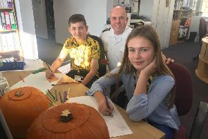 Mackenzie Weir, 11, and Lilley-May Pidgley, 10, busy working on new posters for Halloween and Bonfire Night with Lee  Marsh, Community Fire Safety Officer.
