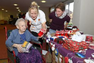 Christmas Fair at Mayfields Care Home. 102-year-old resident Hannah Bailey with Sylvia Markham (carer) looking at Angela Horton's christmas crafts, who was raising money for Boston & Hakusan exchange programme. EMN-181120-163103001