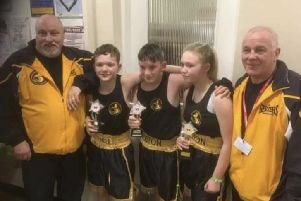 The young boxers in Newark with coaches John Sutton and Kevin Smith.