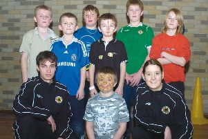 Bobby Smith and Nicola Drummond, Boston United community coaches, with youngsters 10 years ago.