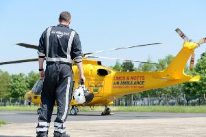 A Lincs and Notts Air Ambulance pilot preparing at base.