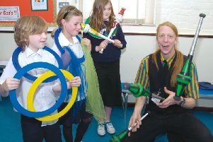 Bradley Gagg, seven, Katie Warren, nine, and Iona Roberts, eights, learn how to juggle.