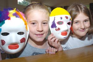 Mask making& pictured, from left, Eleanor Houghton, 10, and Emily Reeson, nine.
