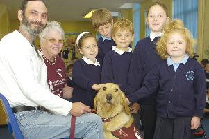 Pictured (from left) Nathan Browning with his dog Bob, June Sponcer, Hearing Dogs for the Deaf volunteer, Emma Henry, Finley Whitaker, Harry Edwards, Lily Rose Smith, and Dempsey Davison.