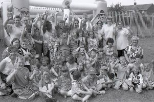 Here we see members of the Rainbow Kids Club celebrating National Kids' Club Week in July 1999. The youngsters held a tropical-themed party to mark the occasion. The event was attended by the Mayor and Mayoress, Coun Paul Goodale and wife Angie.