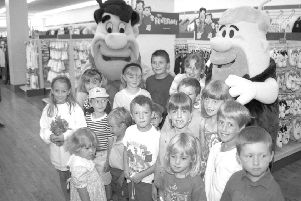 A page right out of history ... Youngsters at Woolworths, in Strait Bargate, Boston, 20 years ago this week, with Fred Flintstone and best friend and next-door neighbour Barney Rubble.